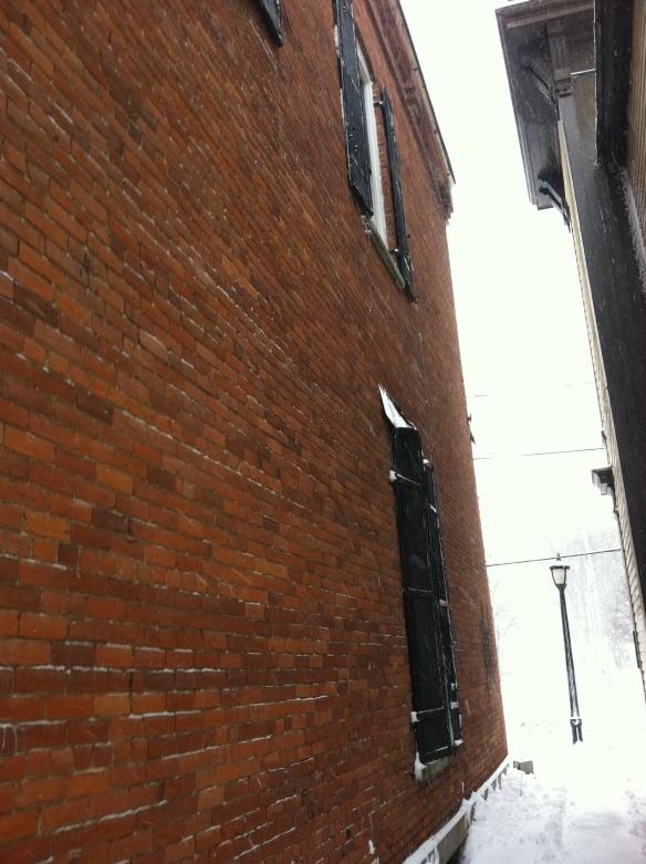 Second floor window overlooking the alley between Stairway Healing Arts Center and Hubbard Hall